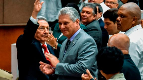 TOPSHOT - Cuban President Raul Castro (L) waves next to First Vice-President Miguel Diaz-Canel (C) during a National Assembly session that will select Cuba's Council of State ahead of the naming of a new president, in Havana on April 18, 2018. Cuban President Raul Castro steps down Thursday, passing the baton to a new generation in a transition that brings to a close the Castro brothers' six-decade grip on power. The 86-year-old has been in power since 2006, when he took over after illness sidelined his brother Fidel, who seized power in the 1959 revolution. / AFP PHOTO / STR        (Photo credit should read STR/AFP/Getty Images)