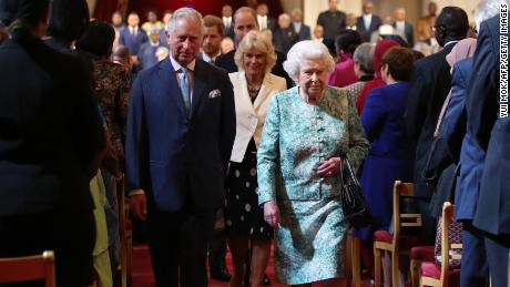 Britain's Queen Elizabeth II and Britain's Prince Charles, Prince of Wales arrive for the formal opening of the Commonwealth Heads of Government Meeting (CHOGM) at Buckingham Palace in London on April 19, 2018. - Britain's Queen Elizabeth II, the Head of the Commonwealth, opened the Commonwealth summit for what may be the last time on April 19, 2018, voicing hope that her son would be allowed to carry on her role. (Photo by Yui Mok / POOL / AFP)        (Photo credit should read YUI MOK/AFP/Getty Images)