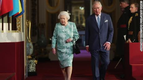 Queen Elizabeth II and Prince Charles attend the formal opening Thursday of the Commonwealth Heads of Government Meeting at Buckingham Palace.