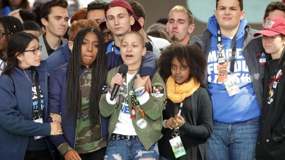 Students from Marjory Stoneman Douglas High School, including Emma Gonzalez, stand together on stage with other young victims of gun violence at the conclusion of the March for Our Lives rally on March 24, 2018, in Washington, DC.