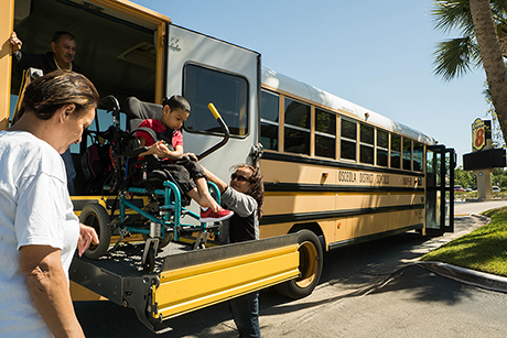 School buses drop off children who evacuated Puerto Rico at motels along US Highway 192 in Kissimmee, Florida.