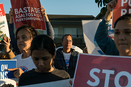 "Carmen ""Millie"" Santiago, center, protests for an extension of FEMA motel aid on April 16."