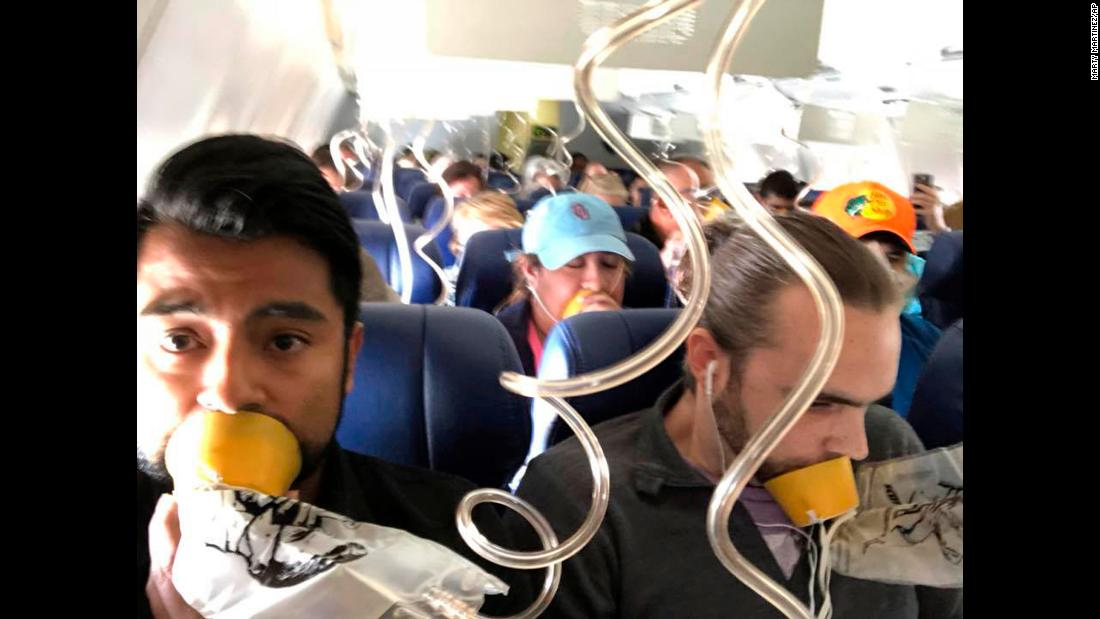 "This photo, taken by <a href=""https://www.cnn.com/videos/us/2018/04/17/southwest-flight-passenger-todd-dnt-tsr.cnn/video/playlists/southwest-airline-deadly-emergency-landing/"" target=""_blank"">Marty Martinez</a>, left, shows passengers aboard Southwest Airlines flight 1380 during an <a href=""https://www.cnn.com/2018/04/17/us/philadelphia-southwest-flight-emergency-landing/index.html"" target=""_blank"">emergency landing</a> in Philadelphia on Tuesday, April 17. <a href=""https://www.cnn.com/2018/04/18/us/southwest-pilot-landing/index.html"" target=""_blank"">The pilot </a>had to land after the plane's left engine failed and parts of it flew off, shattering the window in Row 14, killing one passenger and injuring at least seven others. The National Transportation Safety Board is <a href=""https://www.cnn.com/2018/04/19/us/southwest-ntsb-investigation/index.html"" target=""_blank"">investigating</a> why the engine malfunctioned. <a href=""https://www.cnn.com/2018/04/19/health/oxygen-masks-southwest-emergency-landing/index.html"" target=""_blank"">A lot of people wore their oxygen masks the wrong way during the Southwest emergency landing</a>."