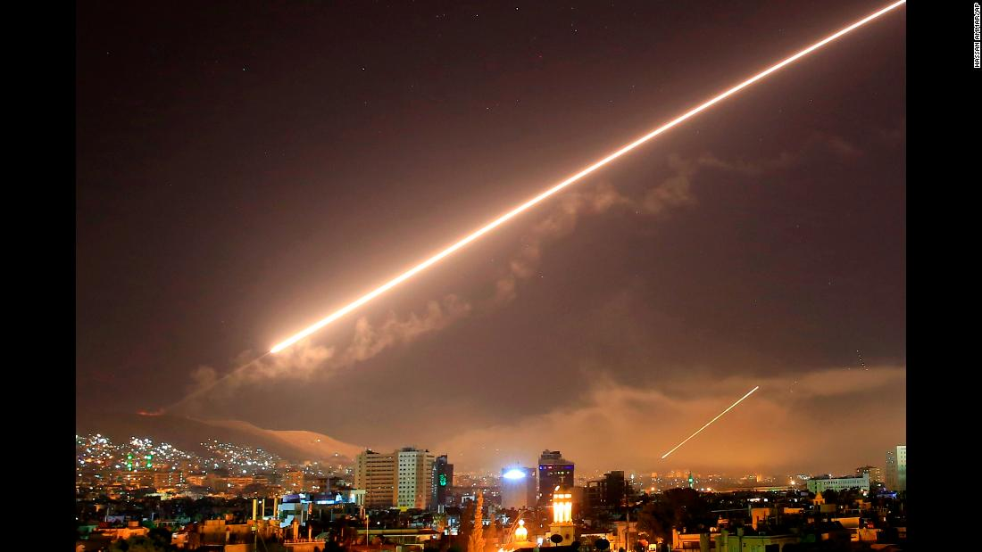 "Missile fire lights the skies above Damascus, Syria, in the early hours of Saturday, April 14. The United States, United Kingdom and France <a href=""https://www.cnn.com/2018/04/13/politics/trump-us-syria/index.html"" target=""_blank"">launched strikes</a> against targets at three sites in Syria, in retaliation against an alleged chemical weapons attack on civilians in the Damascus enclave of Douma. ""I ordered the United States armed forces to launch precision strikes on targets associated with the chemical weapon capabilities of Syrian dictator Bashar al-Assad,"" US President Donald Trump said late Friday at the White House."