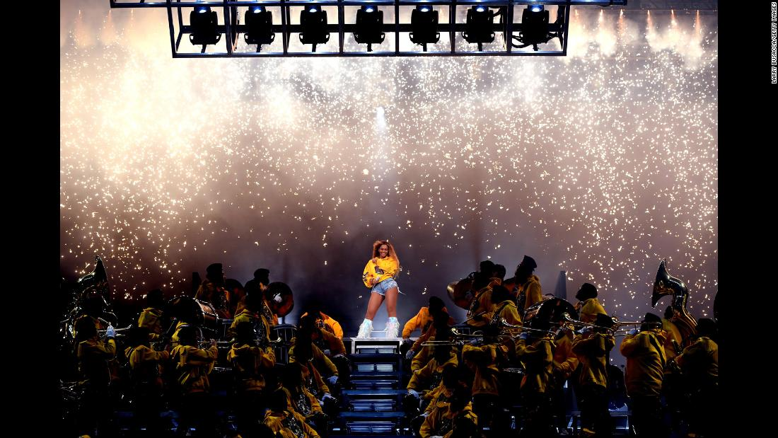"Beyoncé performs at Coachella in Indio, California, on Saturday, April 14. She became <a href=""https://www.cnn.com/2018/04/15/entertainment/beyonce-coachella-performance/index.html"" target=""_blank"">the first woman of color to headline</a> the music festival."