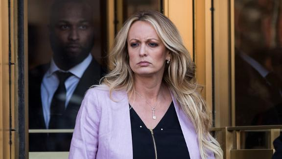 NEW YORK, NY - APRIL 16: Adult film actress Stormy Daniels (Stephanie Clifford) exits the United States District Court Southern District of New York for a hearing related to Michael Cohen, President Trump's longtime personal attorney and confidante, April 16, 2018 in New York City.  Cohen and lawyers representing President Trump are asking the court to block Justice Department officials from reading documents and materials related to Cohen's relationship with President Trump that they believe should be protected by attorney-client privilege. Officials with the FBI, armed with a search warrant, raided Cohen's office and two private residences last week.  (Photo by Drew Angerer/Getty Images)
