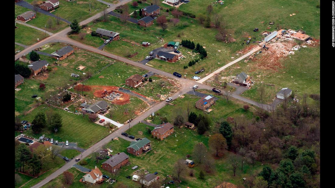 Debris from damaged homes is strewn about the landscape in Elon, Virginia, on Tuesday, April 17. The National Weather Service confirmed a tornado struck areas of central Virginia over the weekend.