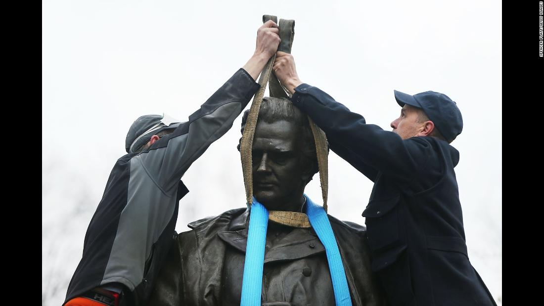 "Parks department workers place a harness over a statue of Dr. James Marion Sims before it is <a href=""https://www.cnn.com/2018/04/17/us/james-marion-sims-statue-removed-from-central-park/index.html"" target=""_blank"">taken down</a> in New York's Central Park on Tuesday, April 17. The city will relocate the statue, erected in 1894, to Green-Wood Cemetery in Brooklyn, New York, where Sims is buried, according to the mayor's office. Sims was a surgeon in the 19th century who conducted experiments on women, usually women of color and mostly enslaved black women. Sims is also looked at in the medical field as a pioneer in the practice of gynecology."