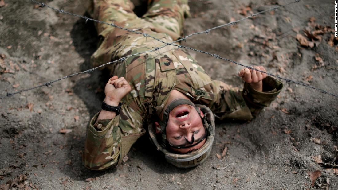 A US Military cadet crawls under a barbed wire obstacle as he competes in the 50th annual Sandhurst Military Skills Competition at West Point in New York on Friday, April 13. The competition is a rigorous two-day event where teams of eight men and women from military academies and universities from 13 countries are tested in multiple military skills, athletic proficiency and leadership abilities.<br />
