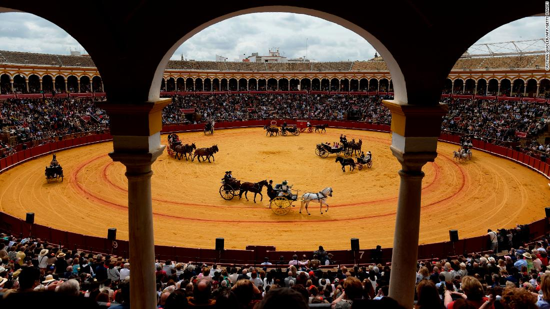 "Horse-drawn carriages are exhibited at the Real Maestranza bullring in Seville, Spain, on Sunday, April 15. <a href=""https://www.cnn.com/2018/04/13/world/gallery/week-in-photos-0413/index.html"" target=""_blank"">See last week in 26 photos</a>"