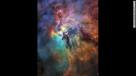 To celebrate its 28th anniversary in space the NASA/ESA Hubble Space Telescope took this amazing and colourful image of the Lagoon Nebula. The whole nebula, about 4000 light-years away, is an incredible 55 light-years wide and 20 light-years tall. This image shows only a small part of this turbulent star-formation region, about four light-years across. This stunning nebula was first catalogued in 1654 by the Italian astronomer Giovanni Battista Hodierna, who sought to record nebulous objects in the night sky so they would not be mistaken for comets. Since Hodierna's observations, the Lagoon Nebula has been photographed and analysed by many telescopes and astronomers all over the world. The observations were taken by Hubble's Wide Field Camera 3 between 12 February and 18 February 2018.