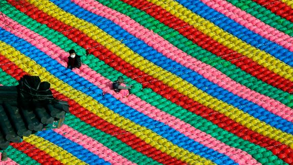 Seoul, South Korea: Lanterns at Jogyesa Temple are adjusted as part of preparations for the celebration of Buddha