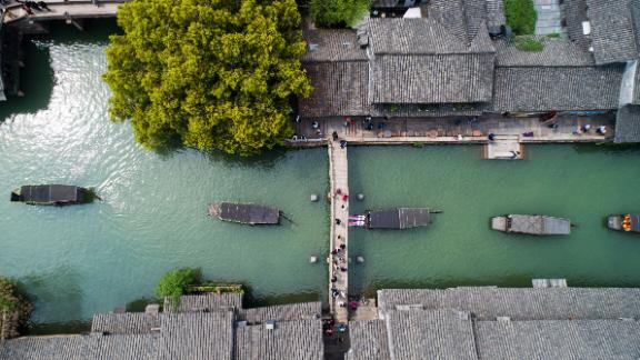 Wuzhen, China: In the town of Wuzhen in Tongxiang, Zhejiang Province, a boat procession is held on April 1 to celebrate Cansheng, the patron god of silkworms.