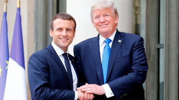 PARIS, FRANCE - JULY 13:  French President Emmanuel Macron welcomes US President Donald Trump prior to a meeting at the Elysee Presidential Palace on July 13, 2017 in Paris, France. As part of the commemoration of the 100th anniversary of the entry of the United States of America into World War I, US President, Donald Trump will attend tomorrow at the Bastille Day military parade.  (Photo by Thierry Chesnot/Getty Images)