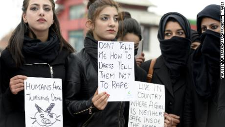 Law students hold placards during a protest calling for justice following the rape and murder of an eight-year-old girl in the Indian state of Jammu and Kashmir, in Srinagar on April 18, 2018.
