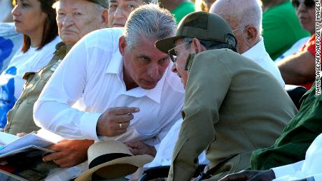 "Cuban President Raul Castro (R) talks with First Vice President Miguel Diaz Canel (L), during the homage for the 50th anniversary of Ernesto ""Che"" Guevara's death, in Santa Clara, Cuba, on October 8, 2017. P / AFP PHOTO / YAMIL LAGE        (Photo credit should read YAMIL LAGE/AFP/Getty Images)"