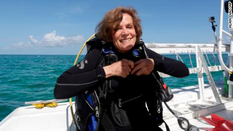 In this Monday, Aug, 11, 2014 photo, marine biologist Sylvia Alice Earle prepares to survey the corals off the coast of Islamorada, Fla. U.S. government scientists hope people will soon be able to go online and get a 360-degree view of reefs and other underwater wonders, much like Google Maps street view lets people look at homes. (AP Photo/Alan Diaz)