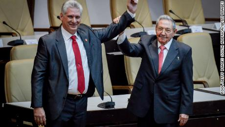 HAVANA, CUBA - APRIL 19: Former Cuban President Raul Castro raises the arm of newly elected Cuban President Miguel Diaz-Canel during the National Assembly at Convention Palace on April 19, 2018 in Havana, Cuba Diaz-Canel will be the first non-Castro Cuban president since 1976. Raul Castro steps down after 12 years in power. (AFP Adalberto Roque/Pool/Getty Images )