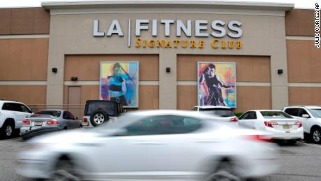 A vehicle drives near the side of the building of an LA Fitness gym, Thursday, April 19, 2018, in Secaucus, N.J. Employees of the LA Fitness wrongly accused a black member and his guest of not paying to work out and called police, prompting an apology from the company. A spokeswoman for Fitness International, parent company of LA Fitness, told The Associated Press that three employees directly involved in the incident are no longer with the company. Tshyrad Oates posted video Monday night of the incident at the club. It shows his unidentified friend, who is a club member, talking to club employees while several police officers look on. On his Facebook page, Oates, who was using a guest pass at the gym, wrote that he and his friend were asked to leave when an employee mistakenly contended the friend hadn't paid for his visit. (AP Photo/Julio Cortez)