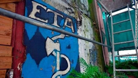 Picture shows an old graffiti depicting the logo of the armed Basque separatist group ETA in the northern Spanish Basque village of Bermeo on February 23, 2018. Basque militant separatist group ETA has put its proposed dissolution to an internal vote, according to extracts of a letter by its leaders published on February 22, 2018 in Basque newspaper Gara. / AFP PHOTO / ANDER GILLENEA        (Photo credit should read ANDER GILLENEA/AFP/Getty Images)