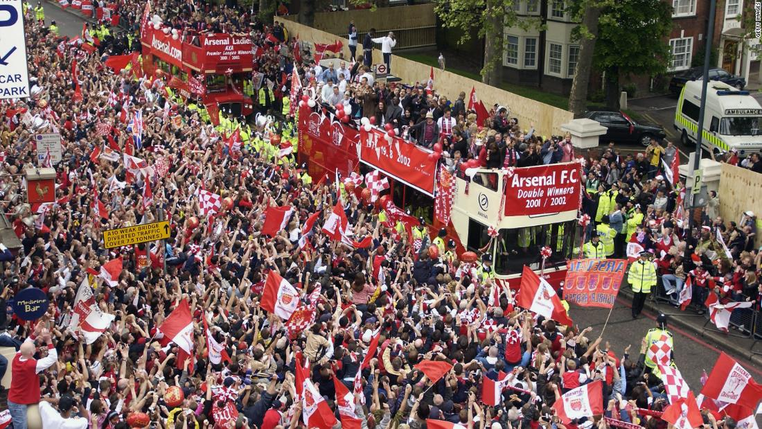 Open top bus parades began the norm for Arsenal fans, this one taking place in 2002.