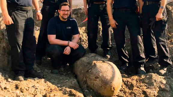 Berlin police bomb squad posing behind the explosive.