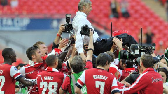 Then finally, after a nine-year drought, Arsenal won silverware once again after beating Hull City in a gripping 2014 FA Cup final. Arsenal players carried their French manager as they celebrated after the match.