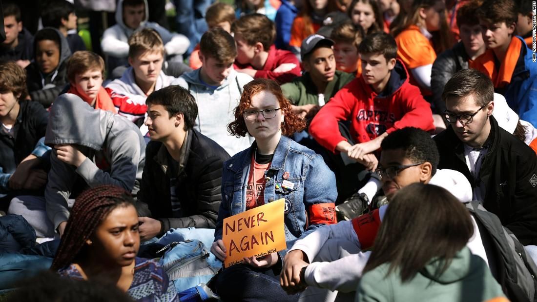 Several hundred high school students from the Washington area observe 19 minutes of silence while rallying in front of the White House before marching to the US Capitol.