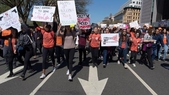 Several hundred high school students march from the White House to the US Capitol to rally against the National Rifle Association (NRA) and call for stricter gun laws in Washington.