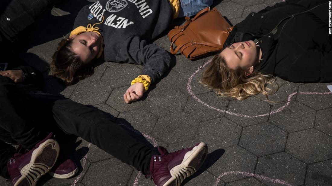 "Student activists participate in a ""die-in"" to protest gun violence at Washington Square Park in New York."