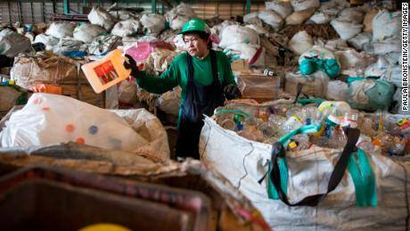 BANGKOK, THAILAND - SEPTEMBER 1 : Worker Kamol Srilaloong manually separates plastic bottles at the Wongpanit Suvarnabhumi recycle collection center on September 1, 2017 in Bangkok, Thailand.  People arrive at the recycling and sorting center with their products, plastic, metal, steel and paper. They are paid by weight according to the market cost. Plastic bottles can be recycled into Polyethylene Terephthalate (PET) bottle flakes and post consumer recycle (PCR) for the textile market IPI -NPT chips. Many plastic items like shopping bags, and food wrapping tend to be used for short periods before being discarded. A recent study stated that Thailand along with China, Indonesia, the Philippines and Vietnam are on the list of the world's top-five plastic polluters. Cleaning up plastic pollution in Thailand is a challenge due to cultural, infrastructure and environmental obstacles.  (Photo by Paula Bronstein/Getty Images)