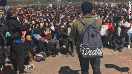 Brendan Smith, a sophomore at Kenwood Academy, addresses a crowd Friday at Chicago's Grant Park.