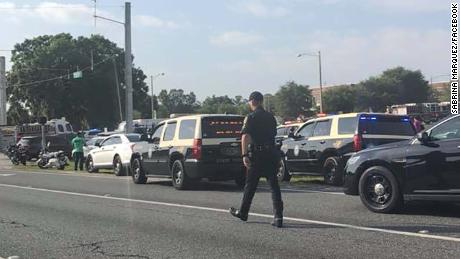 Sabrina Marquez was driving past Forest High School in Ocala, Florida, and took these photos of the scene outside the building after a school shooting that authorities say wounded one student. She does not have children at the school. In the photos you can see students outside the school and police and firefighters outside the building.