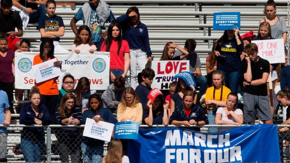 Students at Naples High School, in an effort to revive action on gun reform, walk out of school in Naples, Florida.