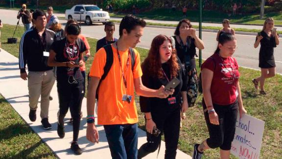 Activist David Hogg, left, and other Parkland students join in the national walkout Friday.