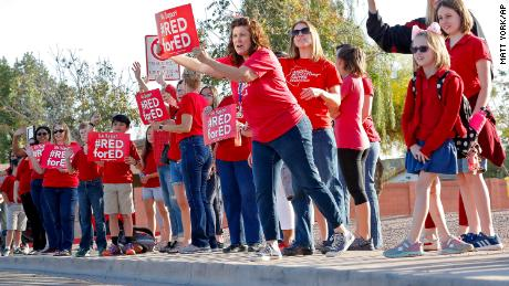 Teachers at Humphrey Elementary in Chandler, Arizona, participate in a statewide demonstration prior to classes on April 11. Thousands of Arizona public school teachers are set to walk out on Thursday.