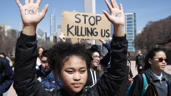 CHICAGO, IL - APRIL 20: A student holds up her hands while taking part in National School Walkout Day to protest school violence on April 20, 2018 in Chicago, Illinois. Students from around the nation joined in the walkout against gun violence on the 19th anniversary of the shooting at Columbine High School where 13 people were killed. (Photo by Jim Young/Getty Images)