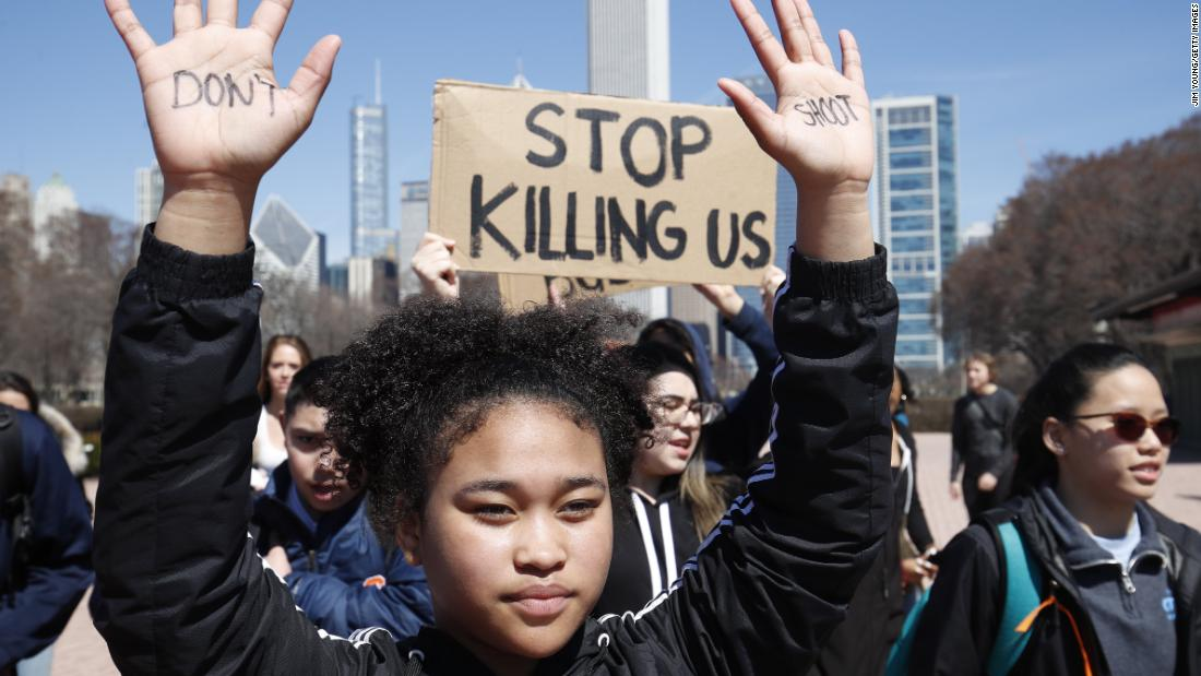 A student holds up her hands while taking part in National School Walkout Day to protest school violence Friday, April 20, in Chicago. Students from around the nation joined in the walkout against gun violence on the 19th anniversary of the shooting at Columbine High School.