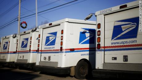 United States Postal Service (USPS) Grumman Long Life Vehicles (LLV) sit parked outside a post office in Shelbyville, Kentucky, U.S., on Thursday, Dec. 22, 2016. More than 30 million packages handled by the USPS are estimated to be delivered on December 22, which is still a fraction of the 750 million packages this holiday season, a 12 percent increase over last year. Photographer: Luke Sharrett/Bloomberg via Getty Images