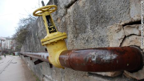 A gas pipe-line runs in Sevastopol on March 4, 2014. The European Union will help Ukraine pay the $2.0 billion it owes to Russian gas giant Gazprom, a top official said Tuesday, as part of an aid package reportedly worth more than one billion euros.AFP PHOTO/ VLADIMIR DOKIN        (Photo credit should read VLADIMIR DOKIN/AFP/Getty Images)
