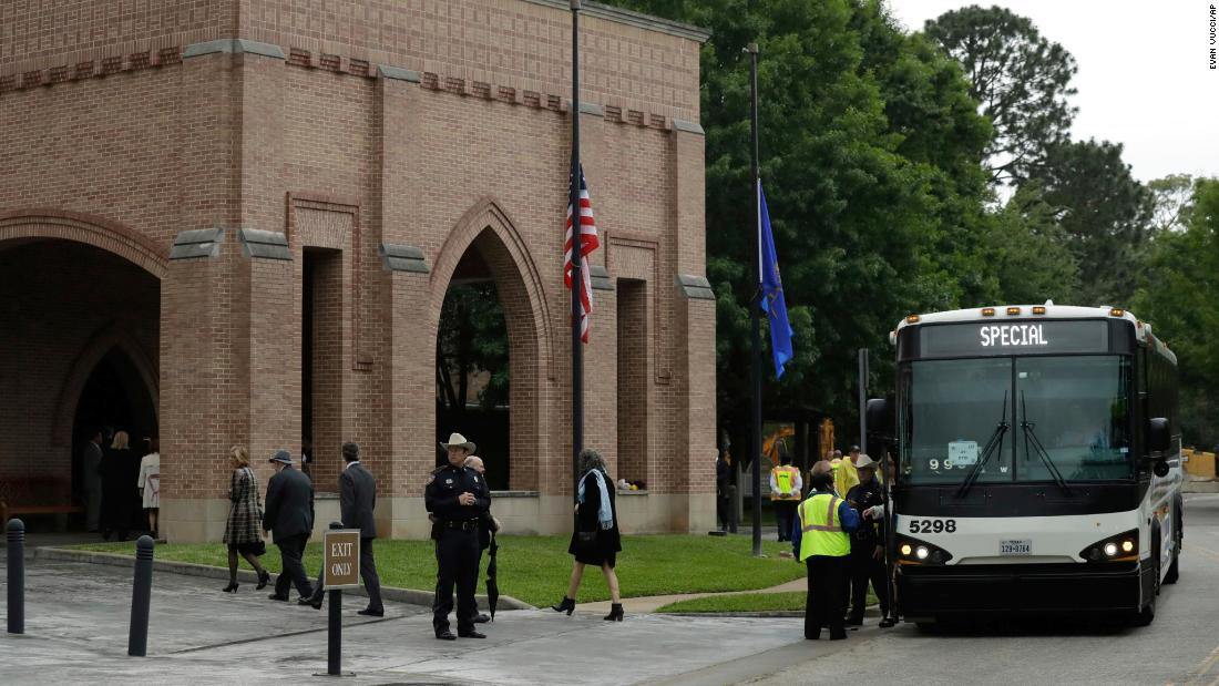 Attendees arrive at St. Martin's Episcopal Church for the funeral service.