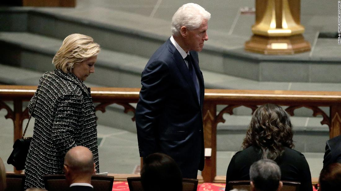 Accompanied by his wife, Hillary Clinton, left, former President Bill Clinton arrives at St. Martin's Episcopal Church.