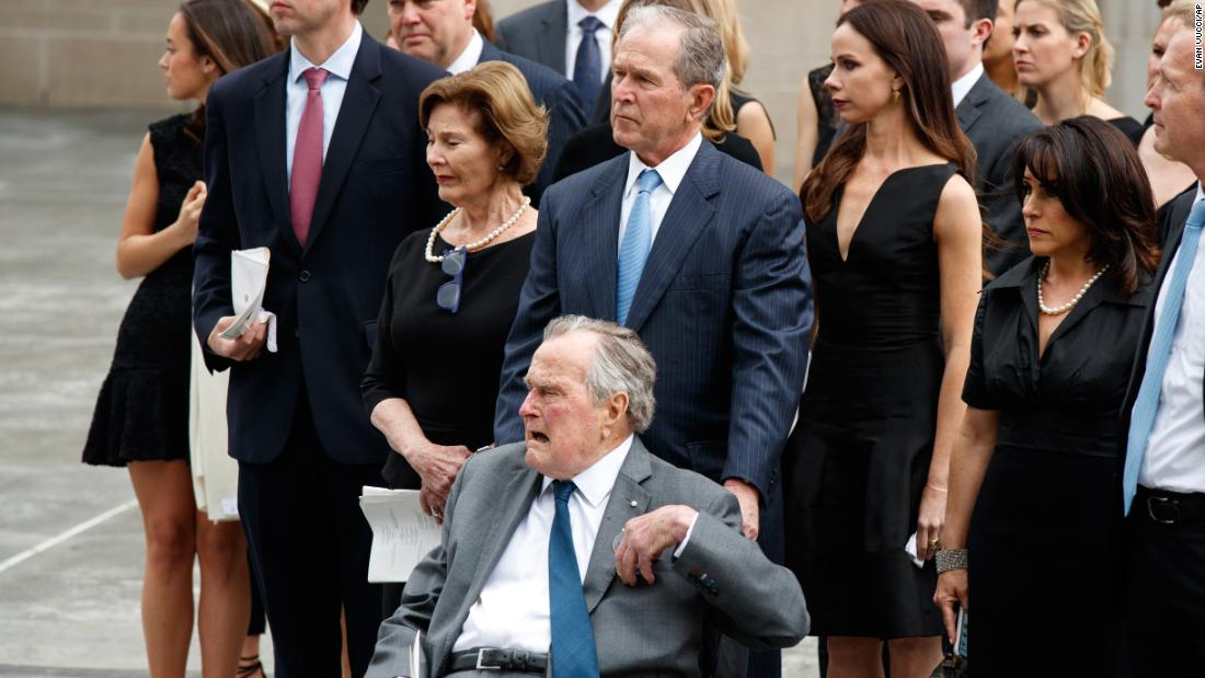 Former President George W. Bush and his father, former President George H.W. Bush, watch as the casket of former first lady Barbara Bush is loaded into a hearse at St. Martin's Episcopal Church.