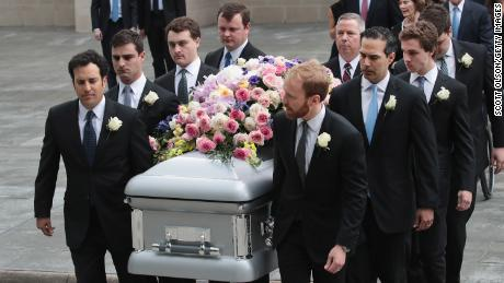HOUSTON, TX - APRIL 21:  The coffin of former first lady Barbara Bush is carried from St. Martin's Episcopal Church following her funeral service on April 21, 2018 in Houston, Texas. Bush, wife of former president George H. W. Bush and mother of former president George W. Bush, died at her home in Houston on April 17 at the age of 92.  (Photo by Scott Olson/Getty Images)