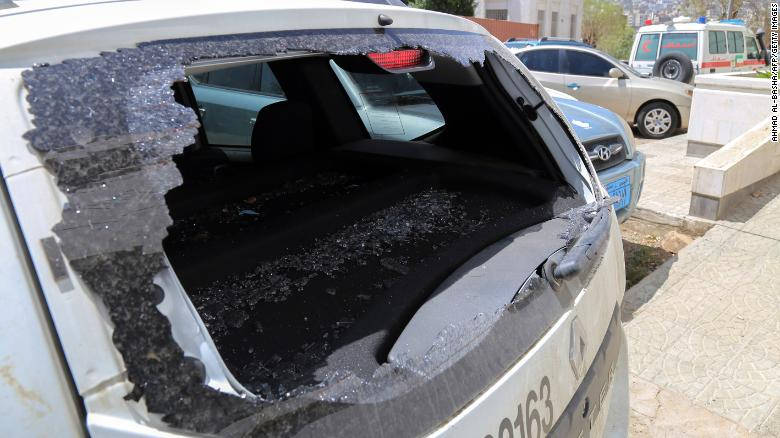 A picture taken on April 21, 2018, shows the shattered rear window of the Red Cross vehicle that was carrying Red Cross employee Hanna Lahoud, parked outside a hospital in the country's third-city of Taiz. - A Red Cross employee was killed in Yemen's southern city of Taez, an ICRC spokesman said, after a gunman had opened fire on an ICRC vehicle in the Zabab district in the west of the city.