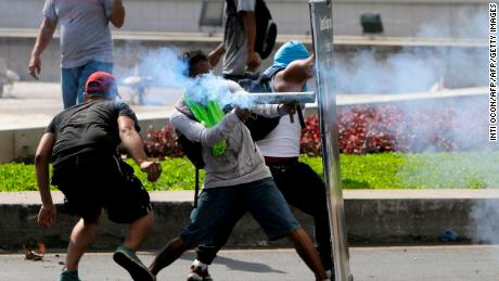 Students clash with riot police during a protest against the government's social security reforms in Managua, Nicaragua.