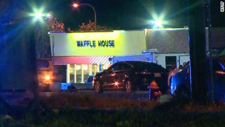 Police say a Waffle House customer snatched the rifle from the gunman.