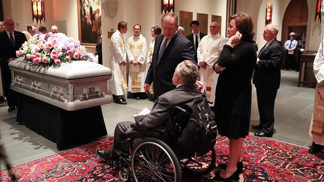 Former presidents George H.W. Bush and George W. Bush in front of the casket of their wife and mother, former first lady Barbara Bush.