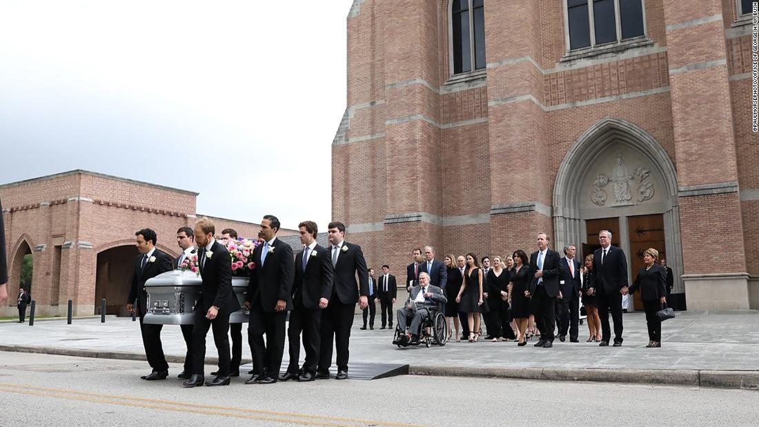 The casket of the former first lady Barbara Bush is carried out of the church by her grandsons in Houston on Saturday.