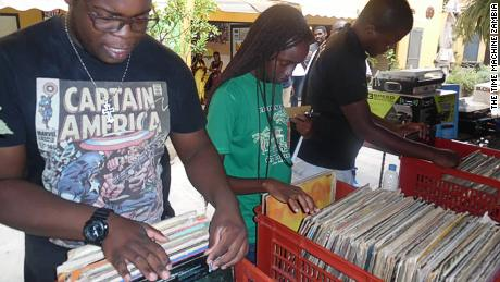 Record collectors digging for vinyl in The Time Machine Zambia, a pop up vinyl store in the capital of Zambia, Lusaka.